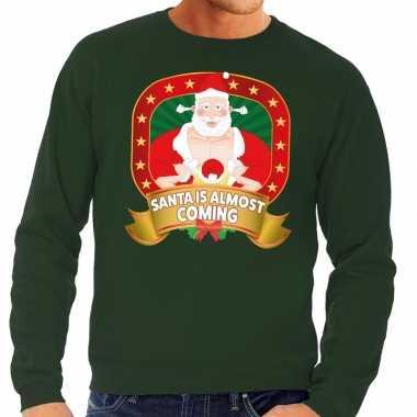 Foute kersttrui groen player kerstman met dame voor heren kopen